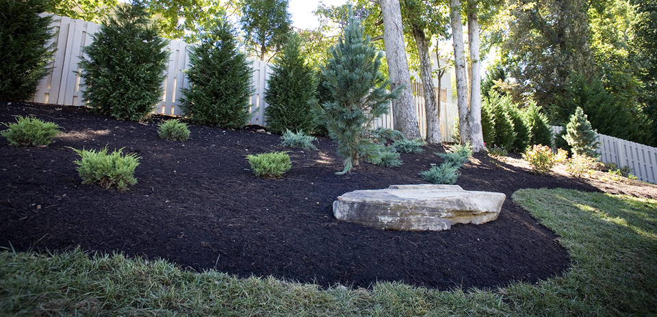 Protect your privacy with the right mix of plants and softly sculpted beds for a pleasing and functional landscape.