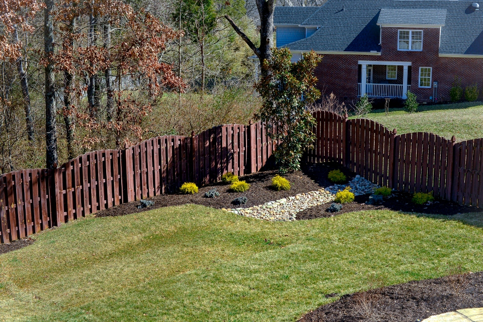 Add funtionality with a complete drainage system that accents the mulched landscape.